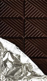 Dark Chocolate Bar in opened silver foil wrapping Royalty Free Stock Image
