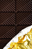 Dark Chocolate Bar in opened silver foil wrapping closeup. Choco Royalty Free Stock Photography