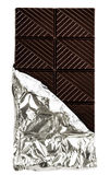 Dark Chocolate Bar in opened silver foil wrapping isolated on wh Stock Photo