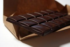 Dark chocolate bar in pack backround. Tasty and healthy food stock photos