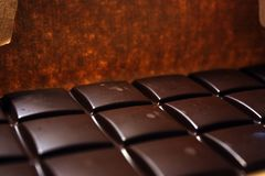 Dark chocolate bar in pack backround. Tasty and healthy food royalty free stock photography