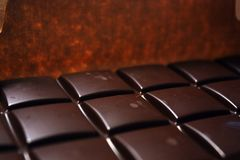 Dark chocolate bar in pack backround. Tasty and healthy food royalty free stock image