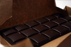 Dark chocolate bar in pack backround. Tasty and healthy food royalty free stock photos