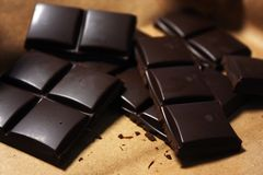 Dark chocolate bar in pack backround. Tasty and healthy food stock photo