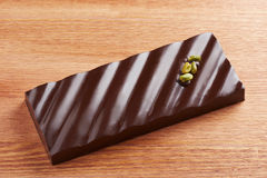Dark chocolate bar with pistachio Royalty Free Stock Image