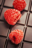 Dark chocolate bar with raspberry Stock Images