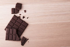 Dark chocolate bar. On wood Stock Photo