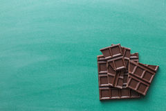 Dark chocolate bars on chalkboard Royalty Free Stock Photography