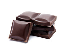 Dark chocolate bars stack with crumbs isolated Stock Images