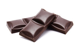 Dark chocolate bars stack with crumbs isolated Royalty Free Stock Photos