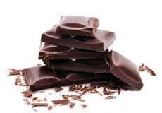 Dark chocolate bars stack with crumbs isolated on a white Stock Images