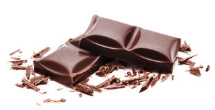 Dark chocolate bars stack with crumbs isolated on a white Stock Image