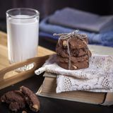 The dark chocolate biscuits with nuts on dark wooden background Royalty Free Stock Photo