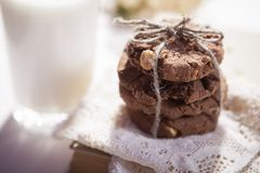 The dark chocolate biscuits with nuts on dark wooden background Royalty Free Stock Photography