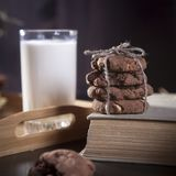The dark chocolate biscuits with nuts on dark wooden background Royalty Free Stock Image