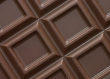 Dark chocolate block background Stock Images