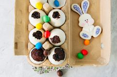 Dark chocolate brownies in egg shells. Easter or funny kids part stock image