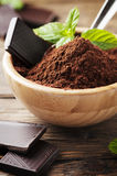 Dark chocolate and cacao on the wooden table Stock Photography