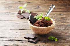 Dark chocolate and cacao on the wooden table Royalty Free Stock Photos