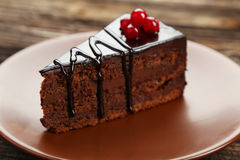 Dark chocolate cake on brown wooden background. Stock Images