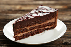 Dark chocolate cake on the brown wooden background Stock Photography