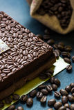 Dark chocolate cake decorated with coffee beans Royalty Free Stock Photos