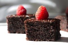 Dark chocolate cake decorated with raspberries Stock Photo