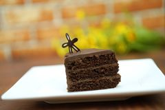 dark chocolate cake and flower royalty free stock photography