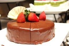 Dark chocolate cake with fresh strawberry Royalty Free Stock Photos