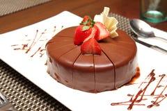 Dark chocolate cake with fresh strawberry Stock Photography