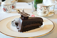 Dark chocolate cake during high tea Royalty Free Stock Photo