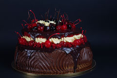 Dark chocolate cake with red cherries Stock Photo