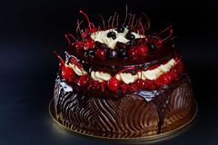 Dark chocolate cake with red cherries Stock Photos