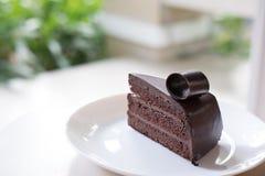 Dark chocolate cake. tasty delicious dessert on white plate. hom Stock Photo