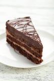 Dark chocolate cake on white wooden background. Stock Images