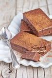 Dark chocolate cakes and spoon Stock Image