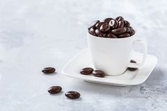 Dark chocolate candies in white coffee cup. Onhelthy food concept with copy space Stock Photo
