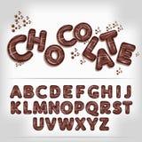 Dark chocolate candy alphabet Stock Image