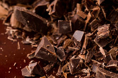 Dark chocolate chunks. Closeup to dark chocolate chunks Royalty Free Stock Photo