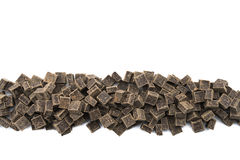 Dark Chocolate Chunks in Row on Isolated White. Background Royalty Free Stock Images