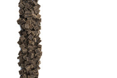 Dark Chocolate Chunks in Vertical Row on Isolated White Royalty Free Stock Photo