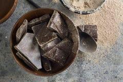 Dark chocolate chunks in wooden bowl Stock Photos