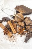 Dark chocolate with cinnamon stick, anise stars and cocoa. Selective focus Royalty Free Stock Photo