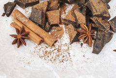 Dark chocolate with cinnamon stick, anise stars and cocoa. Selective focus Stock Photography