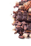 Dark chocolate with cocoa beans Stock Photos