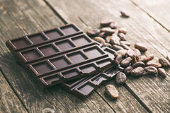 Dark chocolate and cocoa beans Stock Photo