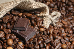 Dark chocolate on coffee beans Stock Image