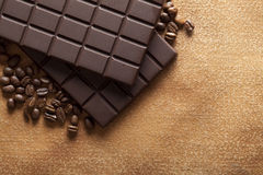 Dark chocolate and coffee beans Stock Images