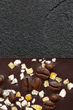 Dark chocolate with coffee grains and fruits on dark stone background. Prepared for the World Chocolate Day, Stock Photo