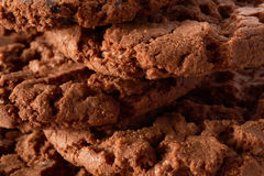 Dark chocolate cookies background Royalty Free Stock Photo